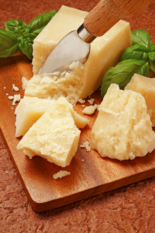 "Parmesan cheese is usually served grated or ""a scaglie"", shavings"