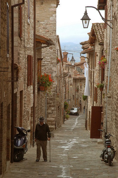 "Cobbled street in Gubbio. Mopeds and ""ape"" are the best ways of transfer through the small alleys of this little town"