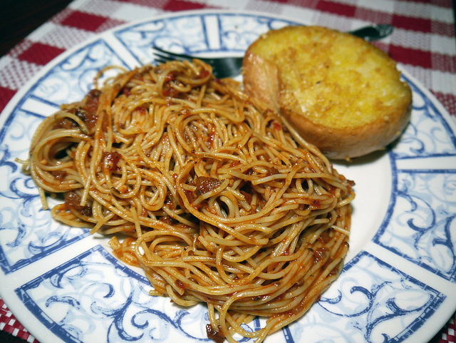 Spaghetti Marinara with garlic bread, often served at italian restaurants in the US, is actually not Italian at all