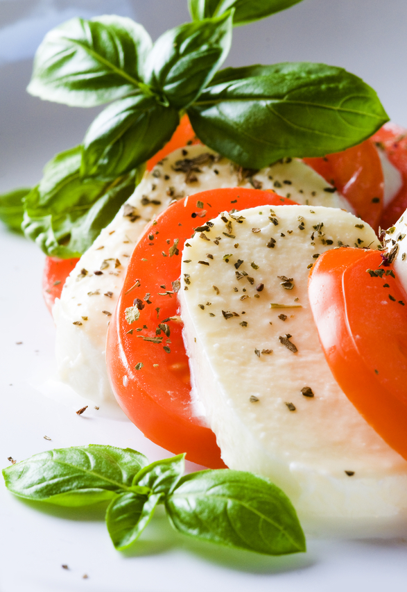 A taste of Italy: three quintessential Italian cuisine's ingredients, mozzarella, tomatoes and fresh basill