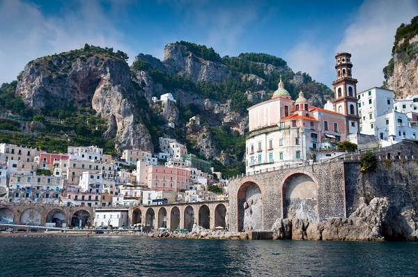 Italy viewed from the sea: the Amalfi Coast, view of the bridge in Amalfi, and the town facing the sea and going up the mountain