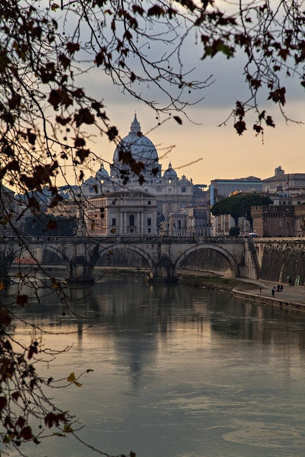 Italy viewed from a river: the Tiber and Rome in the evening