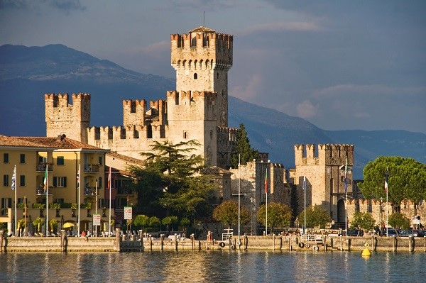 Italy viewed from the water: Castle in Sirmione by Lake Garda