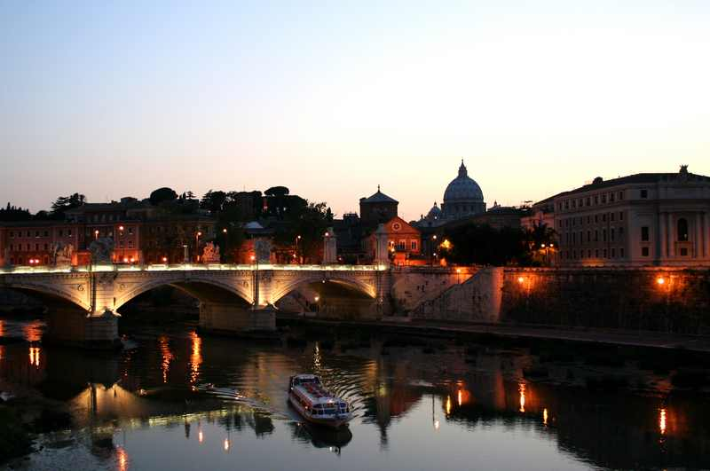 Tiber river and cruise boat in Rome, Italy
