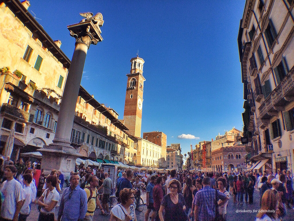 Piazza delle Erbe in Verona on a crowded Sunday afternoon
