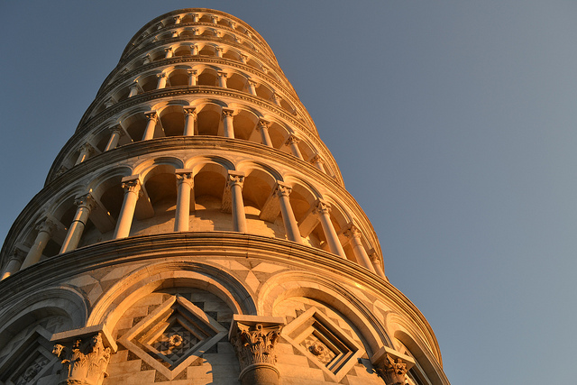 Colors of the sun captured on the white marble surface of the tower of Pisa