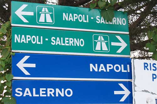 Can you make this up? The green signs show the direction for the Autostrada (the Motorway), the blue signs that to the National road, which is free .